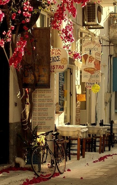A lonely bike waits outside a taverna in Koroni, Greece