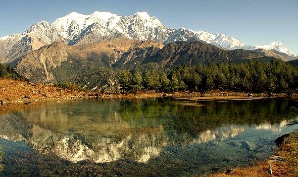 Annapurna Range reflected in Sekong Lake, Nepal
